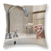 Cleaning Her Hands Throw Pillow