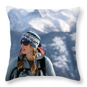 Female Backcountry Skier Skinning Throw Pillow