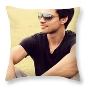 Man In Twenties Relaxing Outside On Green Grass Throw Pillow