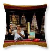 Man Lighting Incense In Chinese Temple Vietnam Throw Pillow