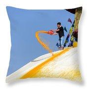 Man Throwing Orange Paint On Boudhanath Stupa Throw Pillow