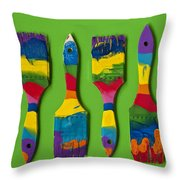 Multicolored Paint Brushes On Green Background Throw Pillow