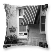 The Cloak Room Throw Pillow