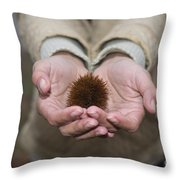 Woman Holding A Chestnut Throw Pillow