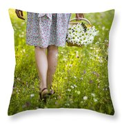 Woman Walking Through A Wild Flower Meadow With A Basket Of Flow Throw Pillow
