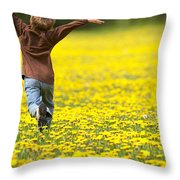 Young Boy Running Through Field Of Throw Pillow