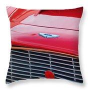 1960 Aston Martin Db4 Grille Emblem Throw Pillow