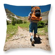 A Backpacker Hiking Throw Pillow