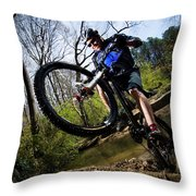 A Man Charges Through A Creek Throw Pillow