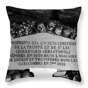 A Marker With Skulls And Bones In The Catacombs Of Paris France Throw Pillow