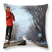 A Woman Running Near A Railroad Track Throw Pillow