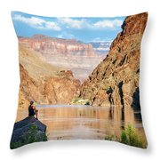 A Woman Sits By The Colorado River Throw Pillow