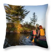 A Young Couple Paddles A Canoe On Long Throw Pillow