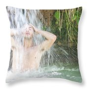 A Young Man Stands Under The Cascades Throw Pillow