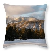 A Young Woman Snowshoes Through Freshly Throw Pillow