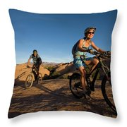 Couple Mountain Biking, Moab, Utah Throw Pillow