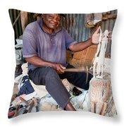 Kenya. December 10th. A Man Carving Figures In Wood. Throw Pillow