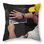 Man Getting A Rubbing Of Fallen Soldier's Name At The Vietnam War Memorial Throw Pillow