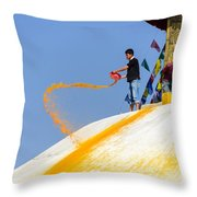 Man Throwing Orange Paint On Boudhanath Stupa Throw Pillow
