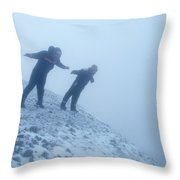 2 Men Leaning Against The Freezing Wind Throw Pillow