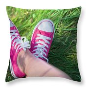 Pink Sneakers On Girl Legs On Grass Throw Pillow