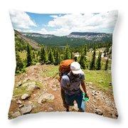 A Backpacker Hiking Throw Pillow
