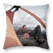 A Man Setting Up A Tent Throw Pillow