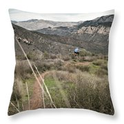 A Young Man Rides His Downhill Mountain Throw Pillow
