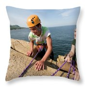 Rock Climbing On Oceanside Cliffs Throw Pillow