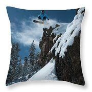 A Male Snowboarder Wearing A Bright Throw Pillow