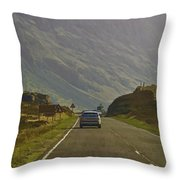 Cars And Other Vehicles On A Road In The Scottish Highlands Throw Pillow