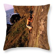 A Man Is Bouldering Near The Ocean Throw Pillow