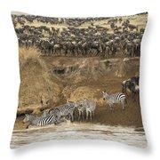 Wildebeests Crossing Mara River, Kenya Throw Pillow