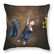 A Baby On The Clothesline Throw Pillow
