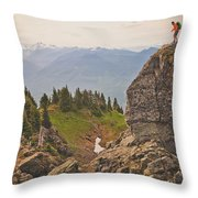 A Backpacker Balances On The Blocky Throw Pillow