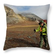 A Backpacker Makes Her Way Throw Pillow