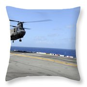 A Ch-47 Chinook Helicopter Landing Throw Pillow