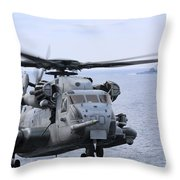 A Ch-53e Super Stallion Conducts Flight Throw Pillow