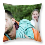 A Climber Holds Ropes Over Shoulder Throw Pillow