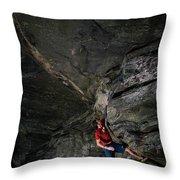 A Climber On A Rock Face Throw Pillow