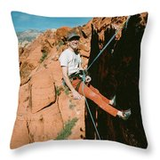 A Climber On Panty Wall In Red Rock Throw Pillow