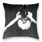 A Contortionist On A Pedestal Throw Pillow
