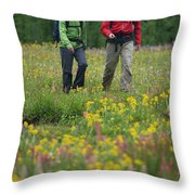 A Couple Hikes Through A Field Throw Pillow