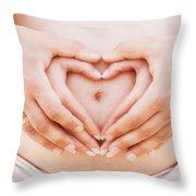 A Couple Making A Heart Shape On The Pregnant Belly With Their Hands Throw Pillow
