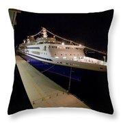 A Cruise Ship At Night Docked Throw Pillow