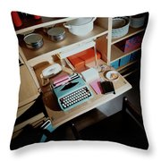 A Cupboard With A Blue Typewriter Throw Pillow