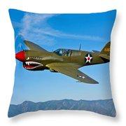 A Curtiss P-40e Warhawk In Flight Throw Pillow