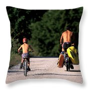A Father And Son Ride Their Bikes To Go Throw Pillow