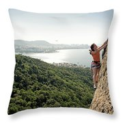 A Female Rock Climber In Action In Rio Throw Pillow