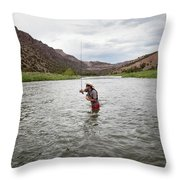 A Fly Fisherman Mends While Fishing Throw Pillow